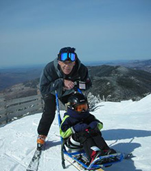 Dr. Medaugh sledding with his son